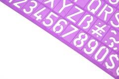 英国信件塑料模板印刷字母表 免版税库存照片