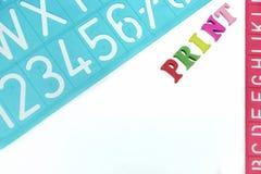 英国信件塑料模板印刷字母表 库存照片