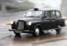 英国出租汽车 库存照片