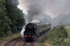 英国印度线在测验运行的蒸汽火车 免版税库存照片