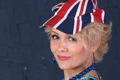 英国国旗盖帽的妇女 免版税库存照片