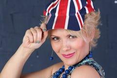 英国国旗盖帽的妇女 库存图片