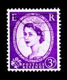 英国女王伊丽莎白二世- Predecimal Wilding, serie,大约1956年 免版税库存照片
