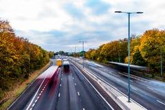 英国机动车路在秋天 免版税库存照片