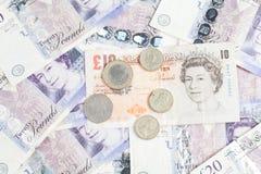 英国混杂的镑和硬币 库存图片