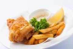 英国筹码鱼快餐桌传统木 免版税图库摄影