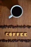 英国词' Coffee' 组成盐薄脆饼干信件 库存照片
