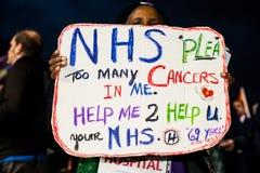 英国需要薪水上升-现在结束盖帽抗议游行 免版税库存照片