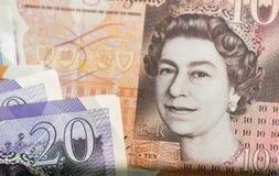 英国bancknotes关闭,包括5磅笔记, 10磅笔记, 20英镑笔记 免版税图库摄影