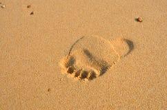 英尺打印沙子 免版税库存照片