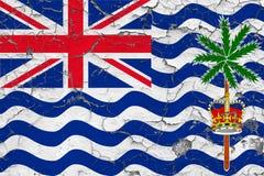 英属印度洋领地旗子在破裂的肮脏的墙壁上绘了 葡萄酒样式表面上的全国样式 图库摄影