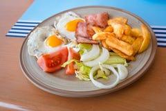 英式早餐鸡蛋和烟肉 图库摄影