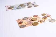 英磅纸币和硬币和欧洲纸币和硬币在白色 免版税库存图片
