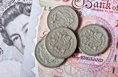 英磅纸币和硬币 库存照片