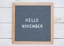 英语发短信给你好在一个信件板的11月在灰色背景的白色信件 免版税库存照片