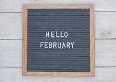 英语发短信给你好在一个信件板的2月在灰色背景的白色信件 免版税图库摄影