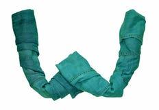 英语字母表从包括各种各样的树荫的牛仔裤衣裳信件被计划 库存照片