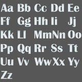 英语字母表被传统化在与纸夹的本文下在白色背景隔离 图库摄影