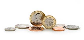 英镑铸造包括新的形状1英镑硬币 库存照片