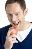 苹果叮咬人采取 免版税图库摄影
