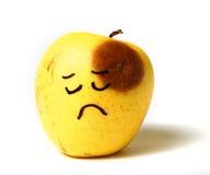 苹果哀伤跳动黑眼睛的伪造品 库存照片