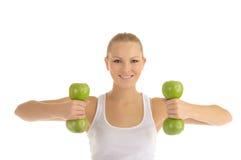 苹果哑铃订了婚健身妇女 图库摄影