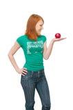 苹果女孩拿着掌上型计算机 免版税库存照片