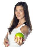 苹果微笑的妇女年轻人 免版税库存图片
