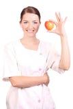 苹果微笑藏品的护士  图库摄影