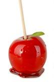苹果查出的奶糖 库存照片