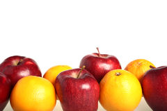 苹果比较桔子 库存图片