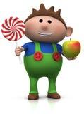 苹果男孩棒棒糖 免版税库存图片