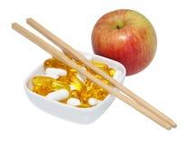 苹果筷子药片 库存图片
