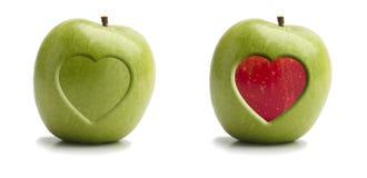 苹果红色和绿色与心脏 库存照片