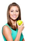苹果绿的微笑的妇女 图库摄影