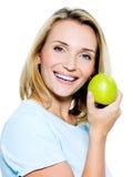 苹果绿的愉快的妇女年轻人 图库摄影