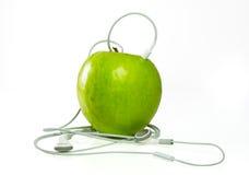 苹果绿的耳机 免版税图库摄影