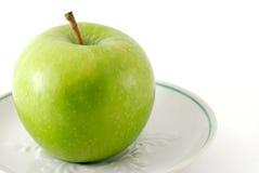 苹果绿的茶碟 免版税库存照片