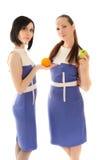 苹果美丽的桔子二妇女 库存图片
