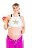 苹果美好的藏品怀孕的微笑的妇女 免版税库存照片