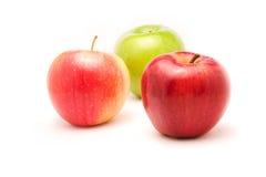 苹果背景三白色 免版税库存图片