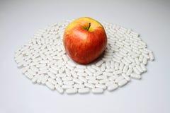 苹果药片 免版税库存图片