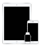 苹果计算机变成银色iPad赞成iPhone 6S和苹果计算机手表垂直大模型 库存图片