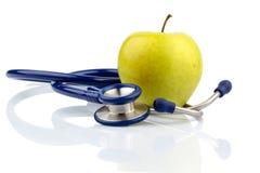 苹果计算机和听诊器 库存照片