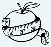 苹果计算机和措施磁带 免版税库存图片