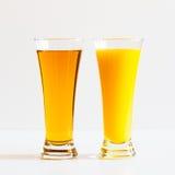 苹果计算机和橙汁 免版税图库摄影