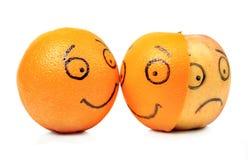 苹果计算机和橙色情感 库存照片