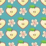苹果计算机和花的心脏在无缝的样式 免版税库存图片