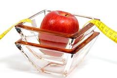 苹果计算机和玻璃 免版税库存照片