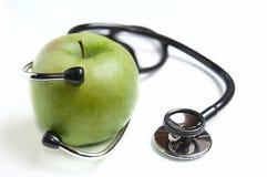 苹果计算机和stetoskop 库存照片